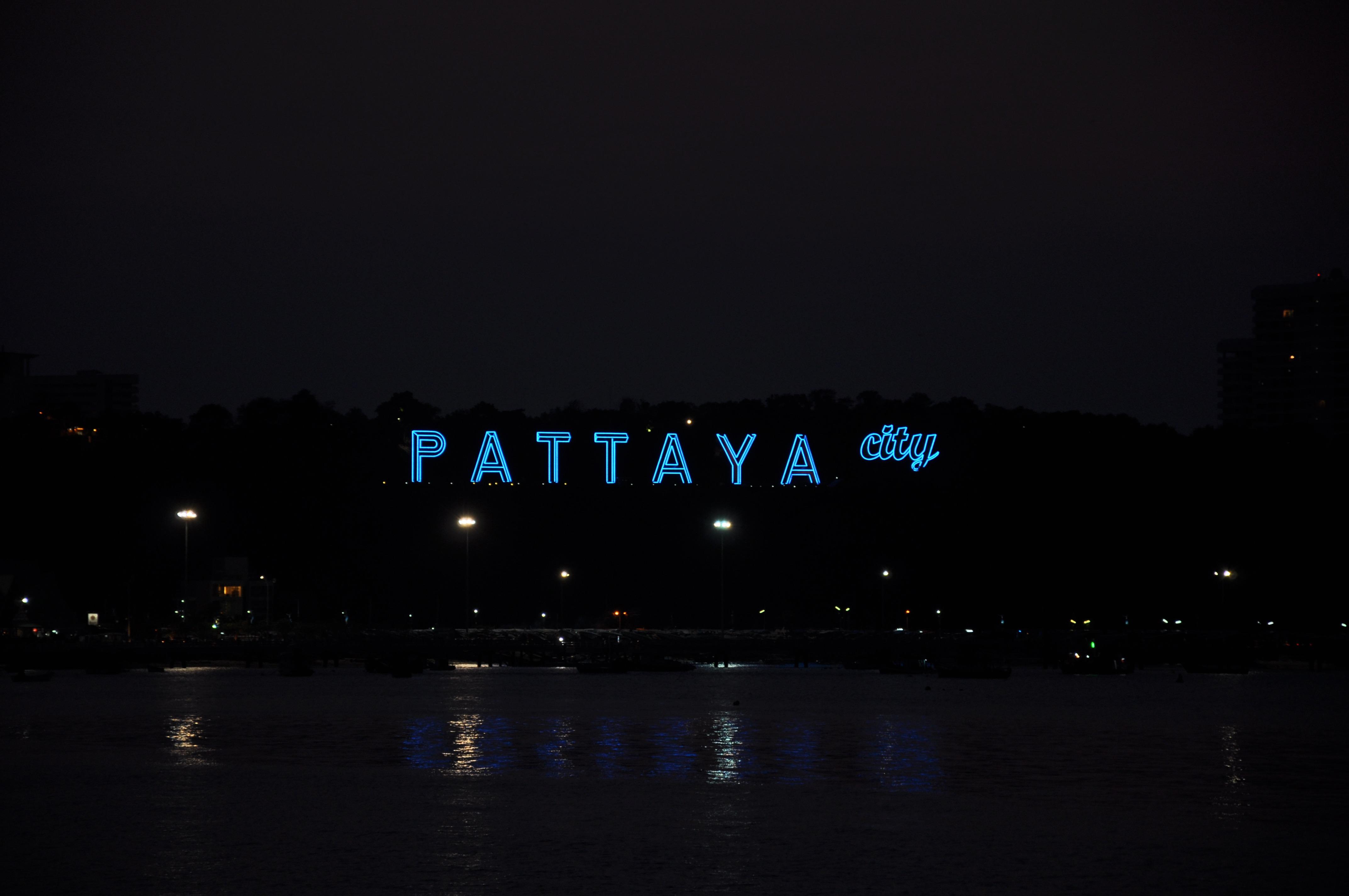 pattaya city sign lit up at night